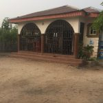 A well-built 4 bedroom bungalow sitting on a full plot of land