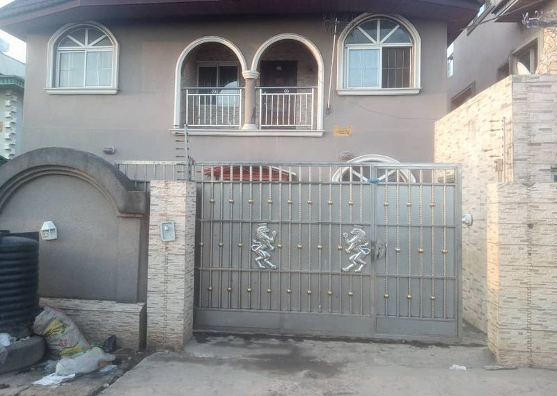 A block of flats for sale in Lagos, Isolo, Ajao Estate